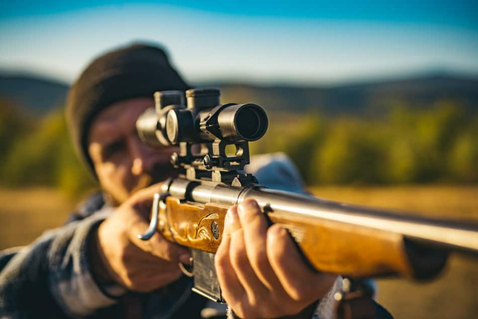 What magnification is needed to shoot for distance